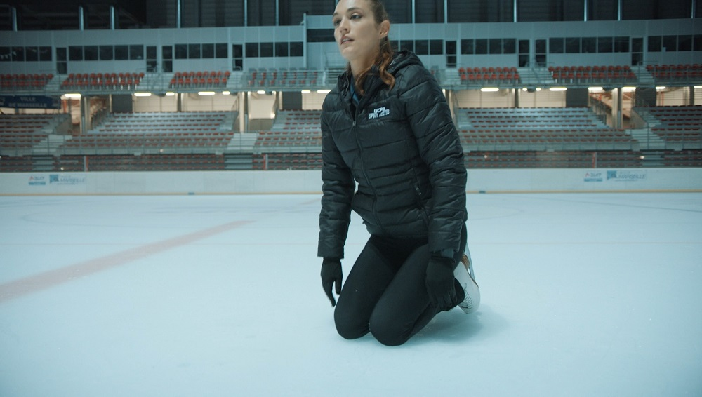 position chute patin a glace