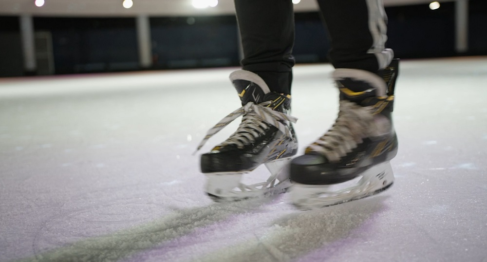 position jambes rotation patin